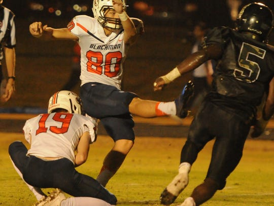 Blackman's Thomas Burks, a Mr. Football Kicker of the Year semifinalists, boots an extra point during Friday's 6A state playoffs win over Hendersonville. He also made a 37-yard field goal.