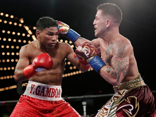 Cuba's Yuriorkis Gamboa, left, fights Jason Sosa during the 10th round of a super featherweight boxing match Saturday, Nov. 25, 2017, in New York. Gamboa won the fight. (AP Photo/Frank Franklin II)