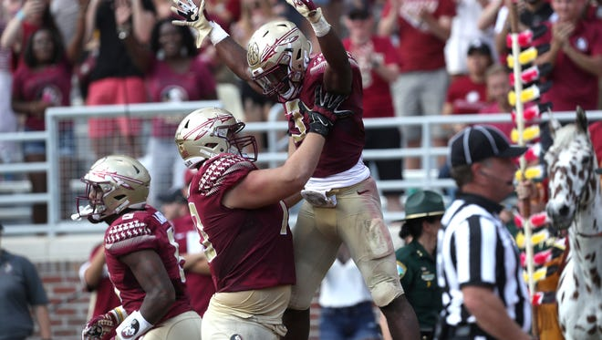 FSU's Cole Minshew celebrates with Cam Akers after his 63-yard TD run against Syracuse during their game at Doak Campbell Stadium on Saturday, Nov. 4, 2017.