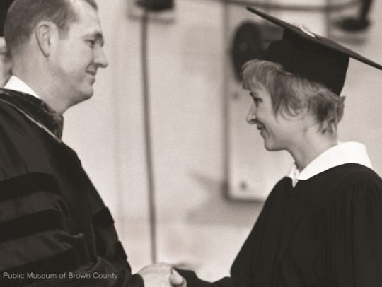Nancy (Ably) DePrey receives the first diploma issued