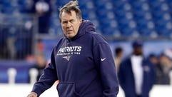 Patriots coach Bill Belichick walks on the field before