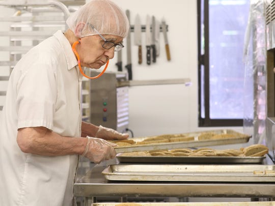 Brother Louis Petruska sorts biscotti pieces onto a tray to be baked for the second time.