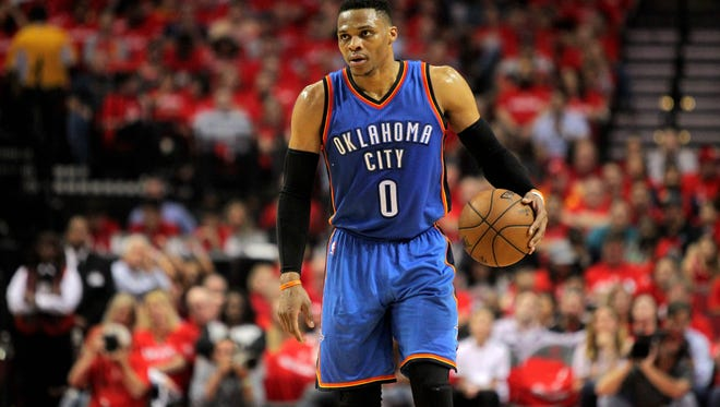 Oklahoma City Thunder guard Russell Westbrook (0) handles the ball during the second quarter against the Houston Rockets in game two of the first round of the 2017 NBA Playoffs at Toyota Center.