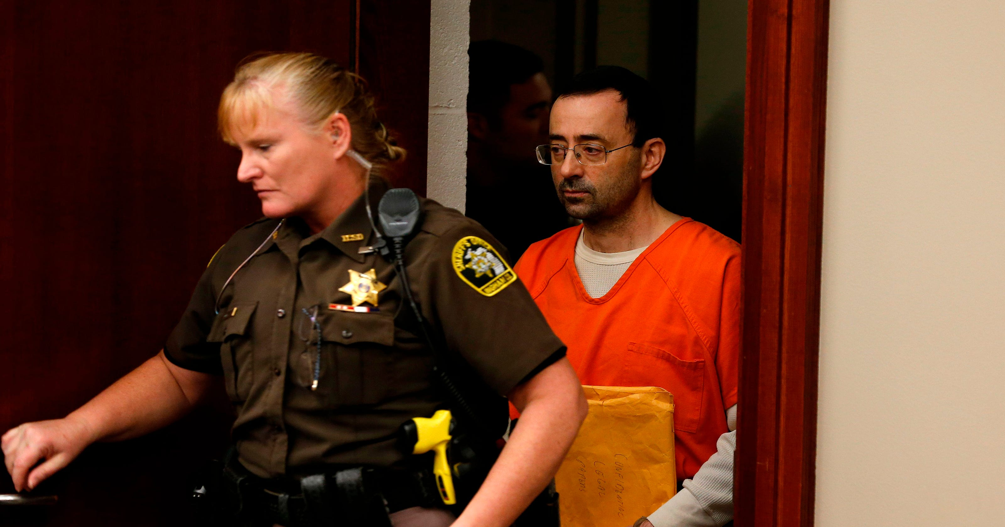 USA Gymnastics doctor Larry Nassar pleads guilty as ...