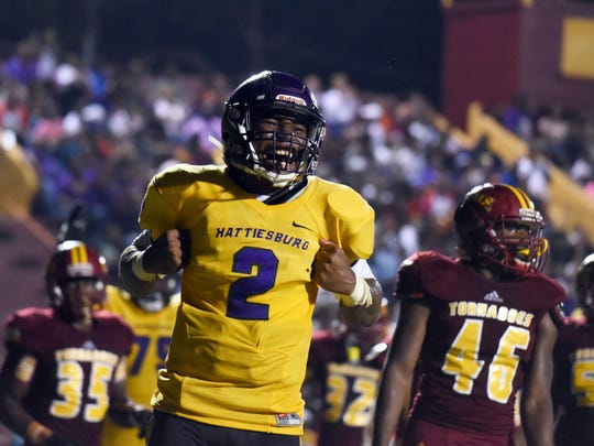 Hattiesburg High quarterback Jarod Conner celebrates after scoring a touchdown in a game against Laurel on Saturday.