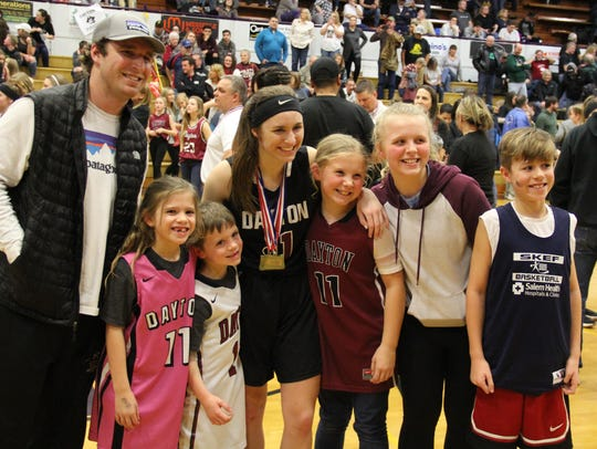 Dayton's Shawnie Spink poses with several relatives