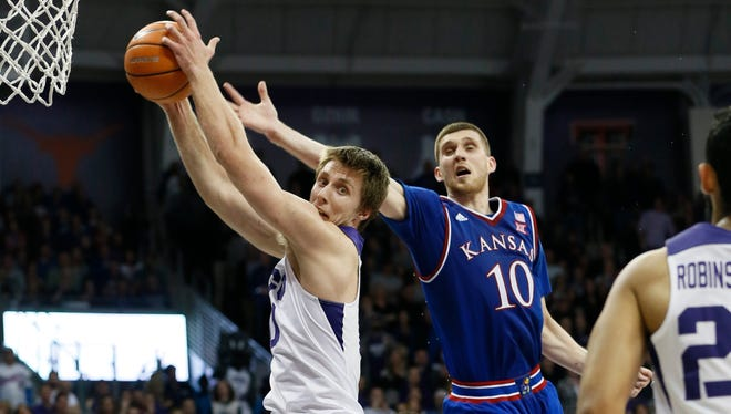TCU forward Vladimir Brodziansky tries to snag a rebound against Kansas guard Sviatoslav Mykhailiuk in the second half at Ed and Rae Schollmaier Arena in Fort Worth, Texas.