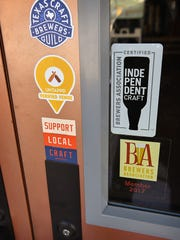 Signage on the doors of Wichita Falls Brewing Company
