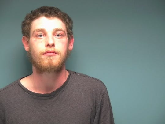 Joshua Delano, 21, was arrested on burglary, arson