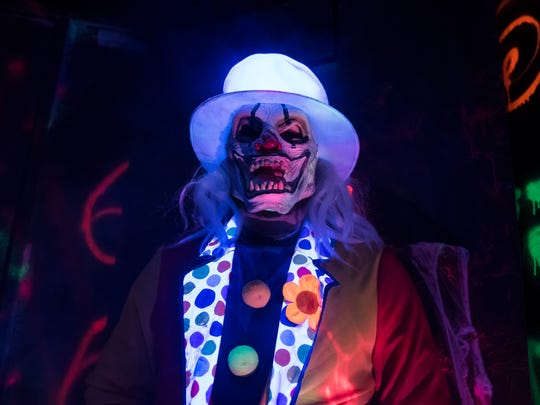 "Greg Durkin Jr. dons a clown costume at ""Land of Fear,"""