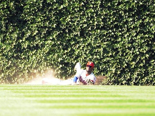 Odubel Herrera of the Phillies makes a catch on Kris