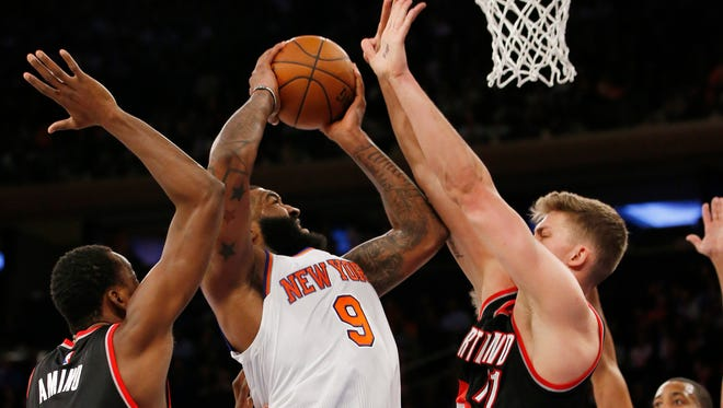 Portland Trail Blazers forward Al-Farouq Aminu (8) and Portland Trail Blazers forward Meyers Leonard (11) defend New York Knicks forward Kyle O'Quinn (9) in the second half of an NBA basketball game at Madison Square Garden in New York, Tuesday, March 1, 2016.  The Trail Blazers defeated the Knicks 104-85.
