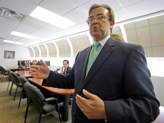 Mexican Consul General Jose Antonio Zabalgoitia talks to reporters as he shows the new offices of the legal Defense Center at the Mexican Consulate General, Friday, March 3, 2017, in Miami. The Mexican government is beefing up its aid to migrants in the U.S. through the creation of 50 legal assistance centers in response to President Donald Trump's measures to curb illegal immigration.