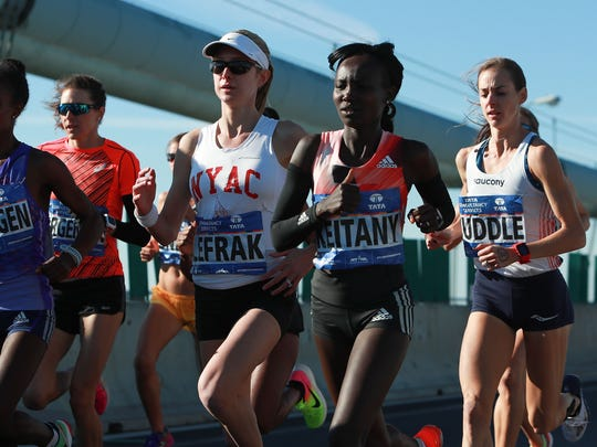 Mary Keitany of Kenya, Molly Huddle of the United States and competitors in the Professional Women's division cross the Verrazano-Narrows Bridge at the start of the 2016 TCS New York City Marathon on November 6, 2016 in the Brooklyn borough of New York City.