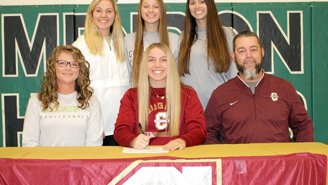 Anna Smith, located center between parents Kim and Mike, will continue her academic and volleyball careers at the College of Charleston. Pictured back are sisters Kaley and Izzy along with Mendon head coach Heather Bowers.