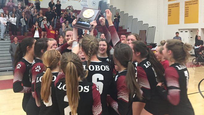The Rocky Mountain volleyball team celebrates its 3-2 regional win over Ralston Valley on Saturday that sent them to the state tournament.
