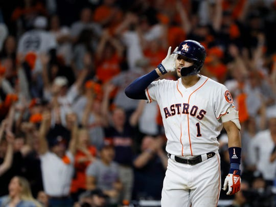 Houston Astros shortstop Carlos Correa celebrates after his walk-off home run against the New York Yankees during the 11th inning in Game 2 of baseball's American League Championship Series Monday, Oct. 14, 2019, in Houston. (AP Photo/Matt Slocum)