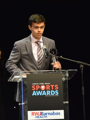 (SPORTS)      06/14/17     Red Bank, NJ Brennan Davis of Southern accepts the award for Boys Volleyball Player Of The Year at the Asbury Park Press Sports Awards on Wednesday at the Count Basie Theater in Red Bank. Frank Galipo/Correspondent ASB 0615 APP Sports Awards Show 18