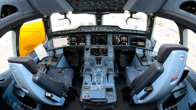 The cockpit of an Airbus A350 XWB plane is shown at the Farnborough Air Show in Hampshire, England, on July 16, 2014.