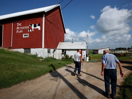 Pete Petersen, 84, right, and his son, Mark, 49, walk to the cow barn on on Aug. 28, 2013, in Appleton.