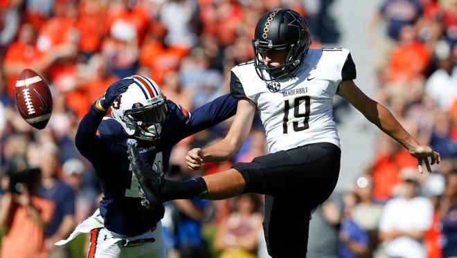 Auburn defensive back Stephen Roberts, left, attempts to block a kick by Vanderbilt punter Sam Loy during the first half of a game Nov. 5, 2016, in Auburn, Ala.