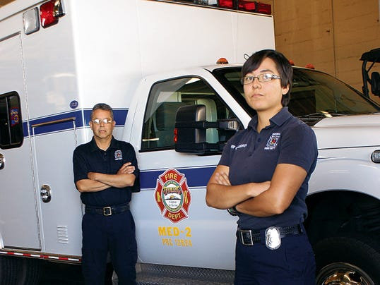 Elena Ruiz - Headlight Photo   Lt. Delbert Rivera and Lt. Antoinette Calderon stand at the ready to answer EMS calls for Luna County. Native Air recognized National Emergency Medical Services week by treating the firefighters/EMTs to a barbecue lunch at the fire house.