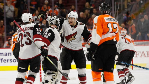 Arizona Coyotes' Luke Schenn, center right, celebrates