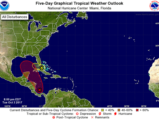 One tropical system is moving west between Cuba and