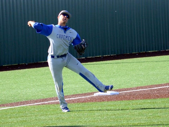 Carlsbad's Seth Olguin throws all the way to first