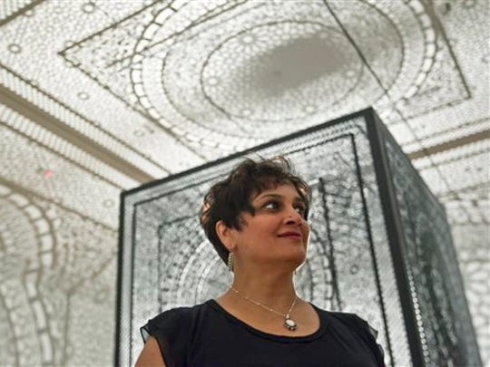 "Indianapolis artist Anila Quayyum Agha won the top prize of $300,000 for her installation ""Intersections"" at the ArtPrize competition Sunday at the Grand Rapids Art Museum in Michigan."