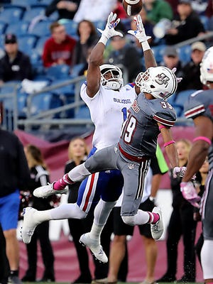 Louisiana Tech's Carlos Henderson leaps over Massachusetts' Isaiah Rodgers while making a touchdown reception during the second quarter of an NCAA college football game Saturday, Oct. 15, 2016, in Foxborough, Mass. (Matthew J. Lee/The Boston Globe via AP)