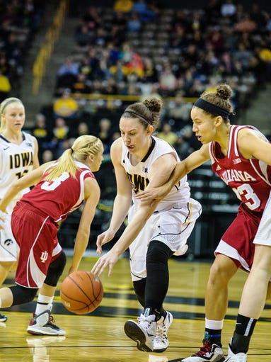 Iowa's Samantha Logic (22) dribbles around Indiana's