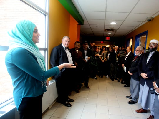 Sidra Ijaz, President of the Rockland Community College Muslim Student Association, speaks during an opening ceremony for the college's Center for Muslim Life office Feb. 25, 2016. The center will serve as a gathering place for Muslim students as well as providing outreach to non-Muslim students at the college. With Ijaz was college president Dr. Cliff Wood.