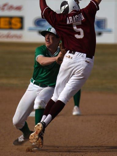 Farmington's Danny Carpenter gets ready to throw to