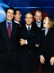 "Jon Stewart (c) with ""The Daily Show"" News Team (l-r):"