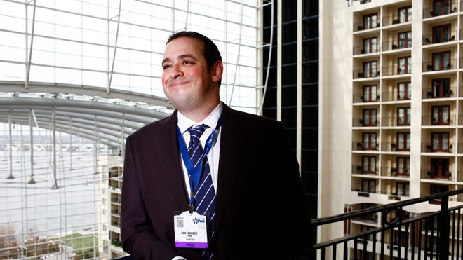 Activist lawyer Dan Backer stands on the balcony of a client's hotel suite Friday at the Conservative Political Action Conference.
