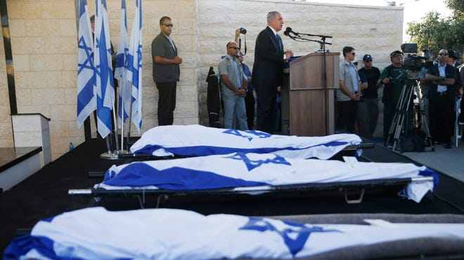 Israeli Prime Minister Benjamin Netanyahu eulogizes three Israeli teens who were abducted and killed in the West Bank during their joint funeral in the Israeli city of Modiin,  July 1, 2014.