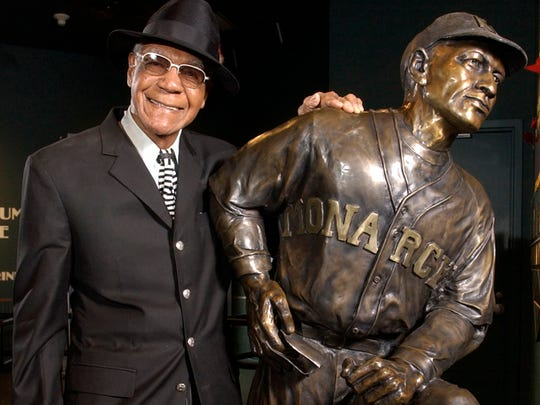 Buck O'Neil stands with a statue of himself in this Feb. 11, 2005, photo at the Negro League Baseball Museum in Kansas City, Mo.