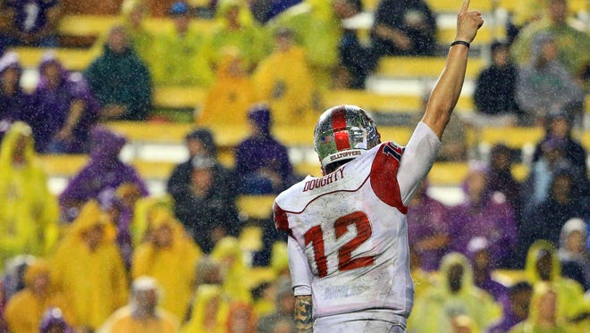 Oct 24, 2015; Baton Rouge, LA, USA; Western Kentucky Hilltoppers quarterback Brandon Doughty (12) celebrates after a touchdown by running back Anthony Wales (not pictured) during the second quarter of a game against the LSU Tigers at Tiger Stadium. Mandatory Credit: Derick E. Hingle-USA TODAY Sports