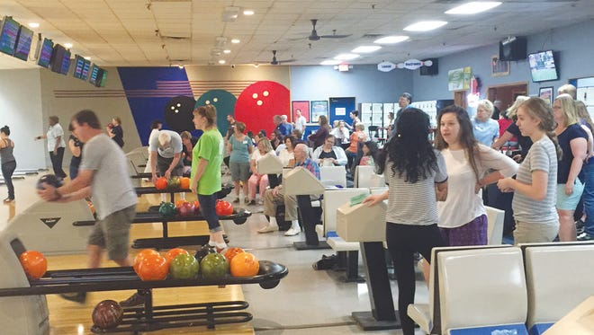 """Bowlers take to the lanes for the Randolph Kiwanis """"Pins 4 Pets"""" event."""