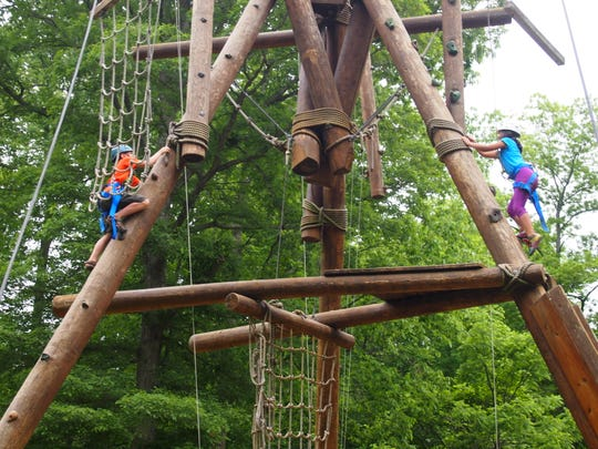 IPS fourth-graders climb a tower at Flat Rock YMCA Camp.