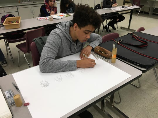 Kaio Huvaere at work during his first-hour art class. He's taking home top honors Monday and moves on to the regional competition.