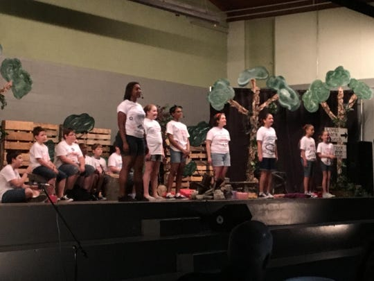 "Family Christian School hosted a dinner theater at the school Friday night, including an auction and performance of ""Down by the Creek."""