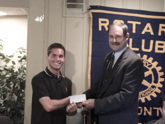 Hammonton Rotary Foundation Scholarship winner Dante Galletta accepts congratulations and a check from Jerry Daunoras, club treasurer.