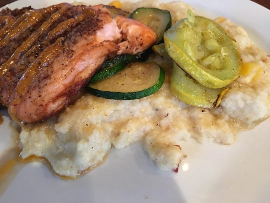 Steelhead with chipotle and mustard, served with grilled summer squash and zucchini.