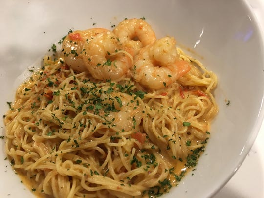 Venetian Shrimp Cappelini, a bed angel hair pasta topped with juicy shrimp and a delicate diced tomato shrimp sauce.