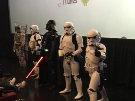 "Darth Vader and friends introduce the first showing of ""Rogue One"" Thursday night at the Tulare Galaxy Theatres."