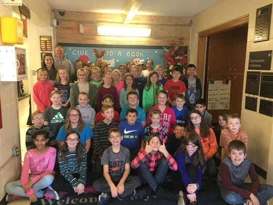 Clayton Elementary School students raised $878 to purchase