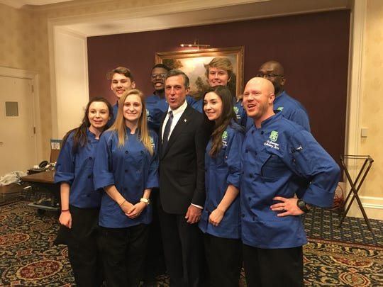 St. Georges culinary arts students with Gov. John Carney Jr. at his inaugural celebration include, from left, front row, Katie Satta, Kassie Lange, Natalie Konschnik, and instructor David Lattomus; back row,Jack Dalton, Miles Evans, Robert Dawson and co-op coordinator Jermaine Williams.