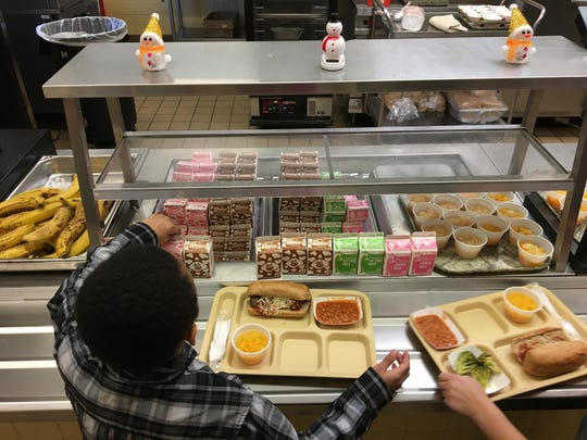 FILE - In this Jan. 25, 2017, file photo, students fill their lunch trays at J.F.K Elementary School in Kingston, N.Y. (AP Photo/Mary Esch, File)